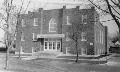 A black and white photo of the brick front of of the church in 1932.